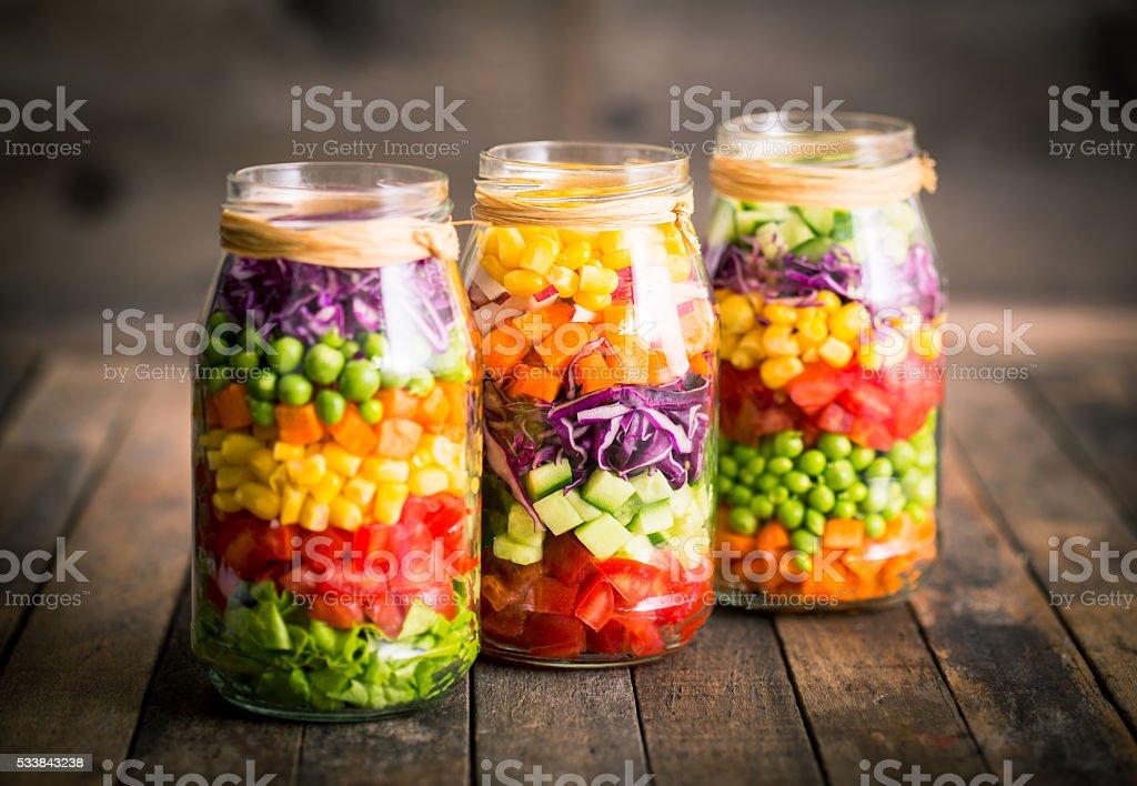 Fresh vegetable salad in a mason jar stock photo