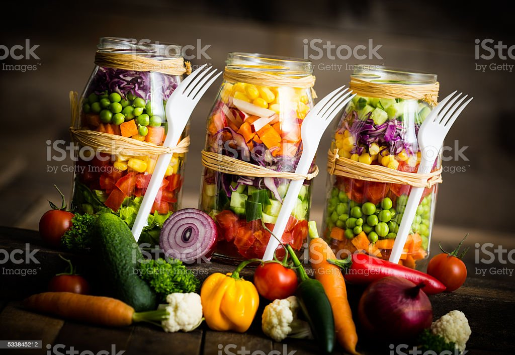 Fresh vegetable salad in a mason jar stock photo