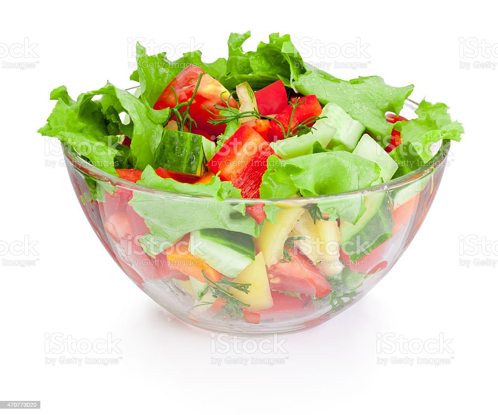 Fresh vegetable salad in glass bowl isolated on white background stock photo