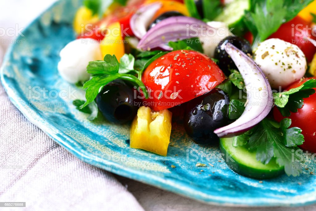 Fresh vegetable salad with mozzarella cheese stock photo