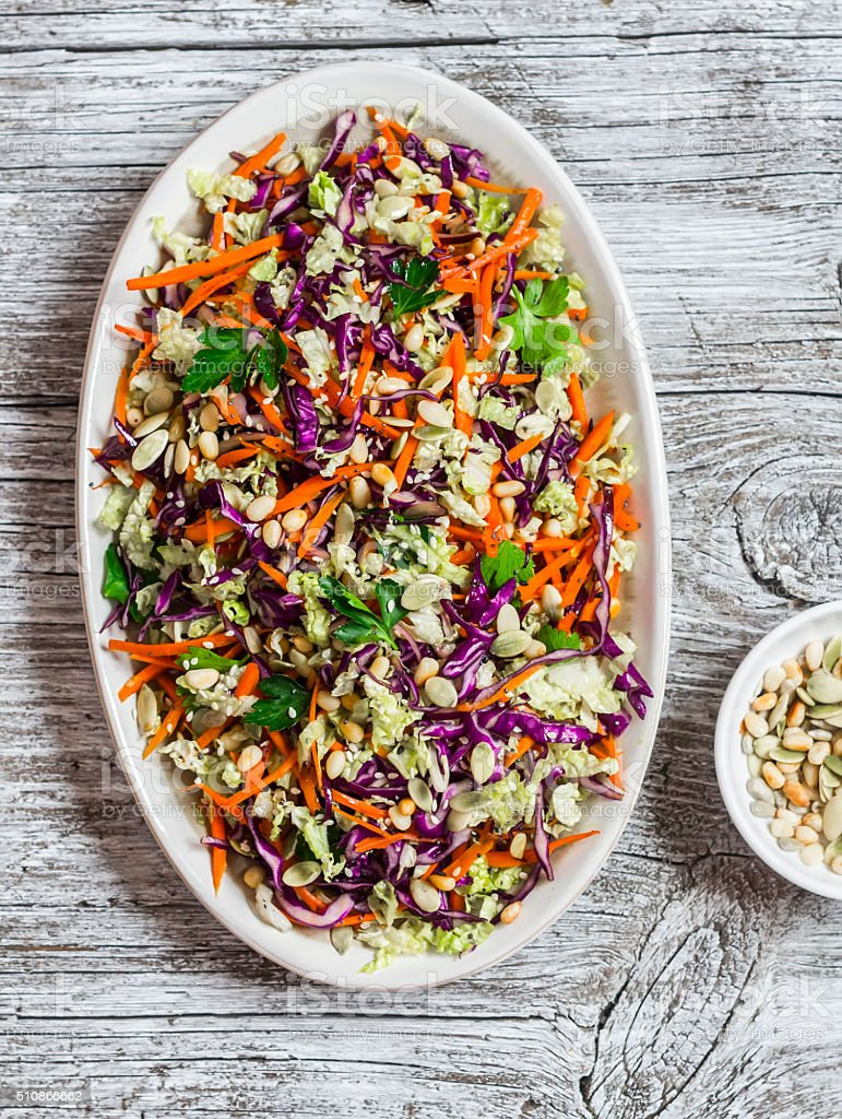 Fresh vegetable salad with red cabbage, carrots, peppers and seeds stock photo