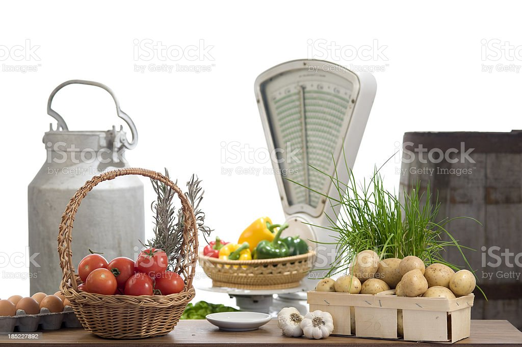 Fresh vegetables and a vintage weight scale royalty-free stock photo