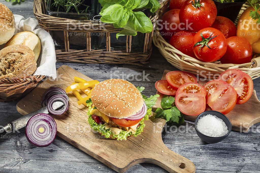 Fresh vegetables and herbs as ingredients for homemade hamburger royalty-free stock photo