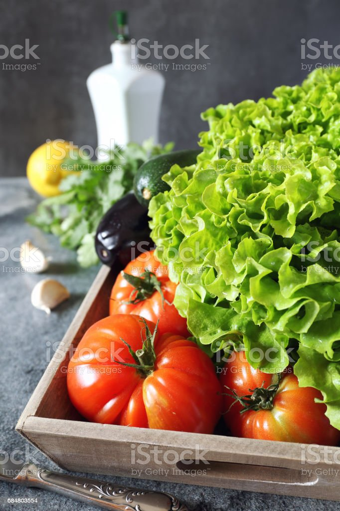 Fresh vegetables and olive oil stock photo