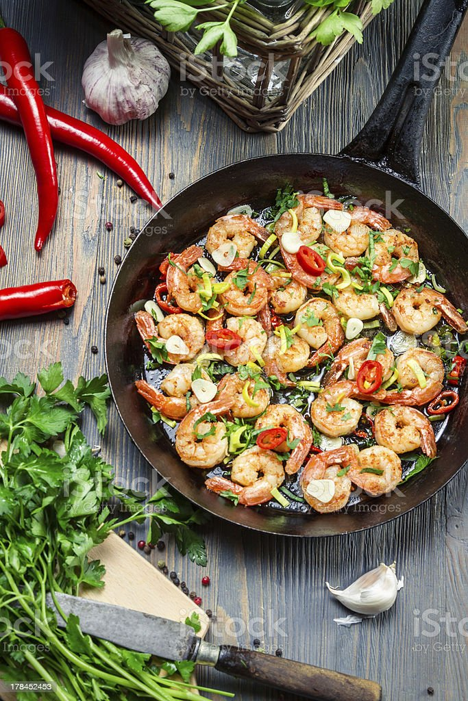 Fresh vegetables and shrimps on old pan stock photo