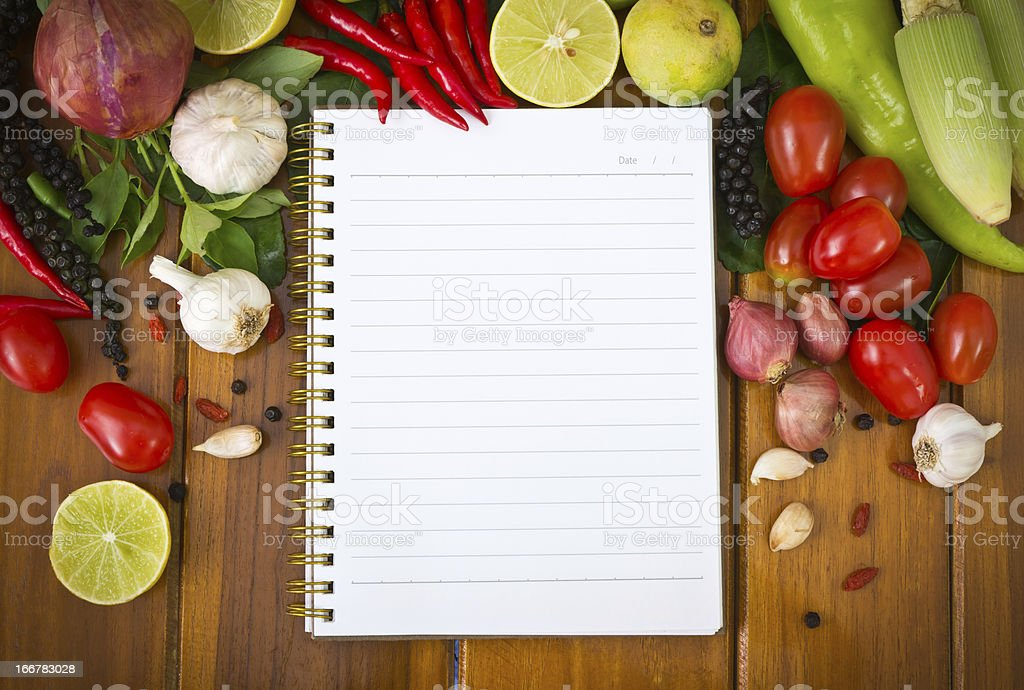 Fresh vegetables and spices with paper for notes stock photo