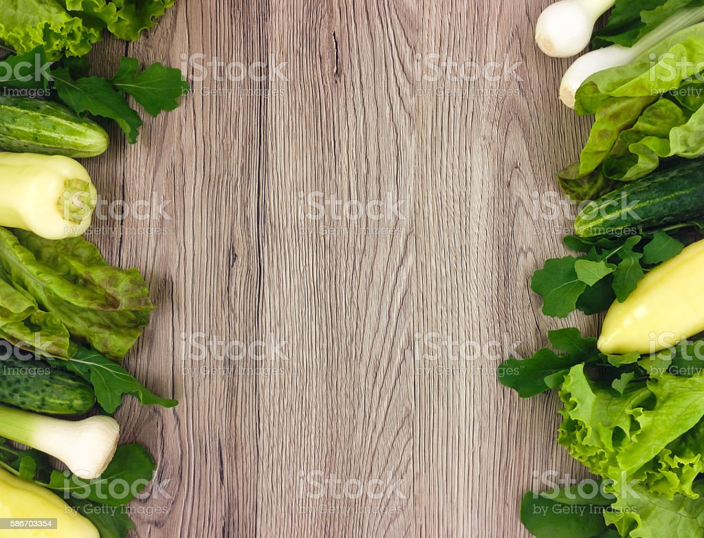 Fresh vegetables colorful frame on wooden background. Flat lay stock photo