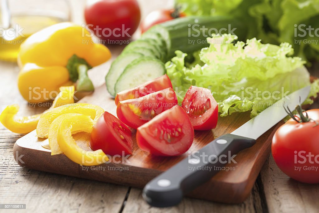 fresh vegetables cucumber tomatoes pepper and salad leaves stock photo