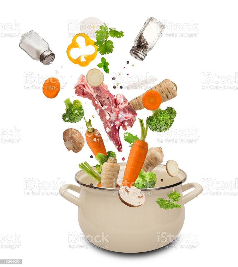 Fresh vegetables falling into stainless steel pot stock photo