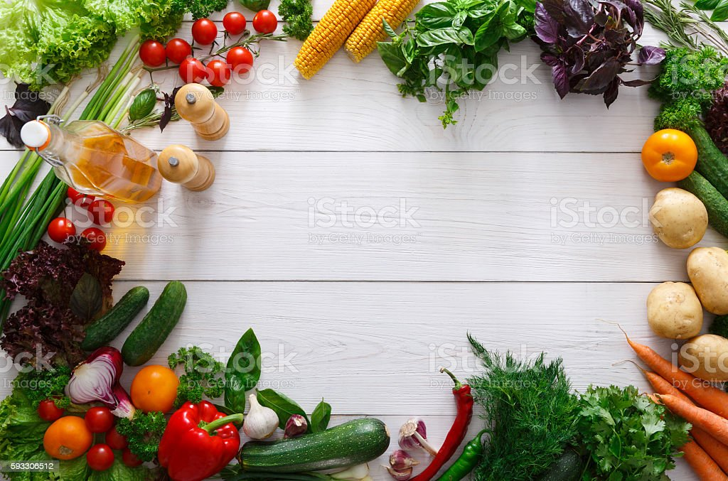 Fresh vegetables frame on white wooden background with copy space stock photo