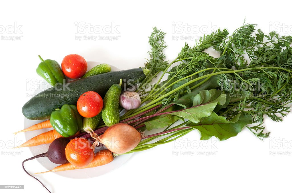 Fresh vegetables from the garden on a white plate royalty-free stock photo