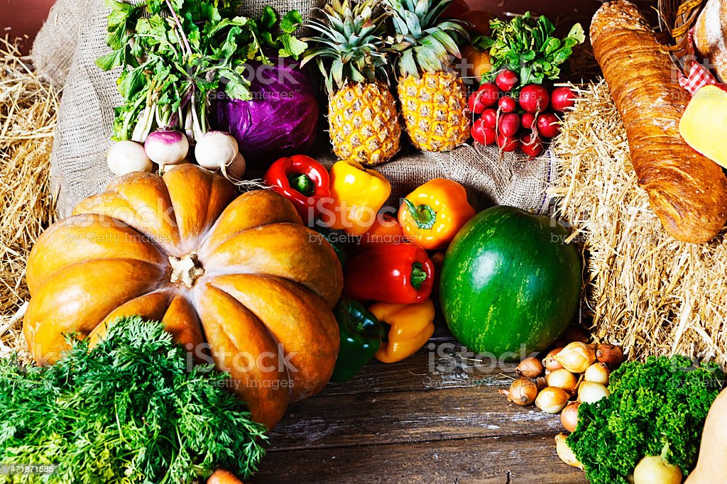 Fresh vegetables, fruit, bread, and cheese at farmers market royalty-free stock photo