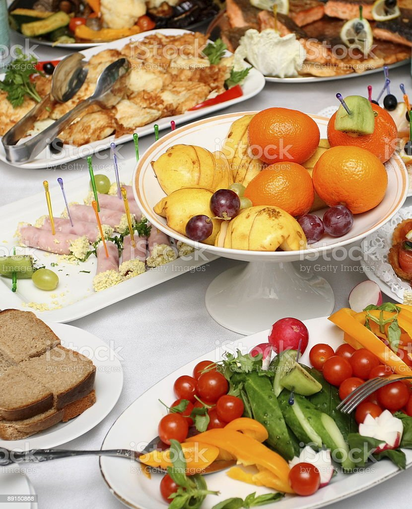 fresh vegetables, fruits and appetizers on served banquet table stock photo