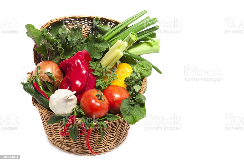 Fresh vegetables in basket isolated on white royalty-free stock photo