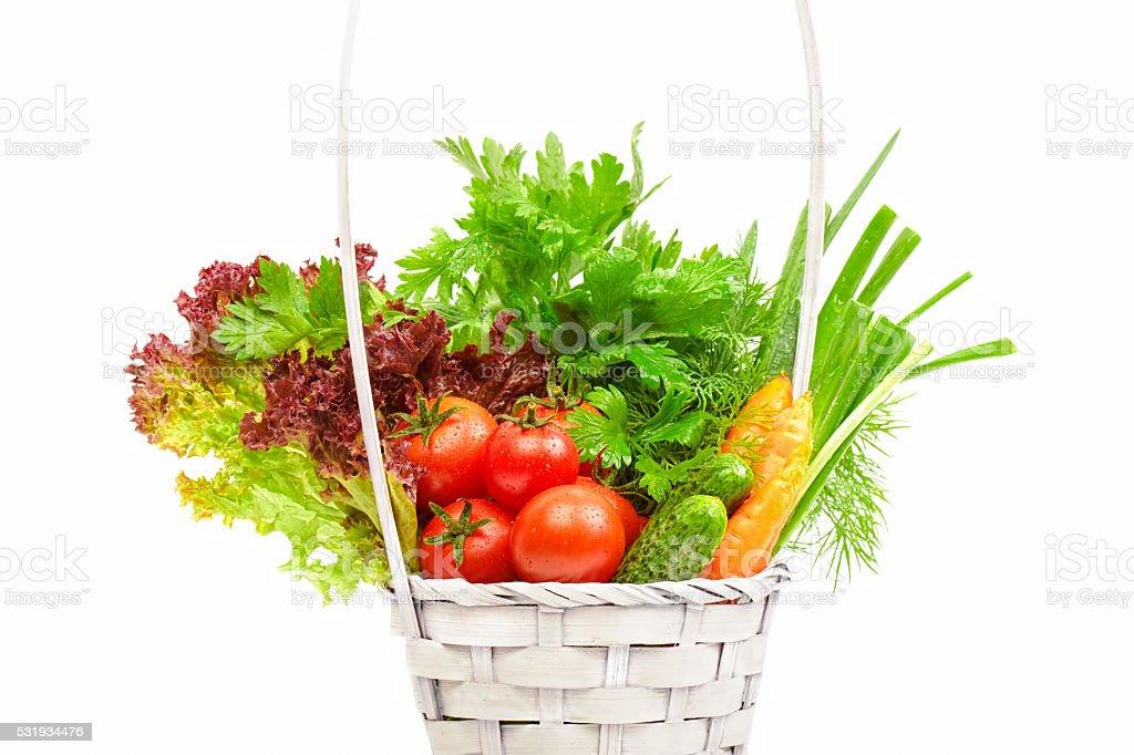 Fresh vegetables in basket on white background stock photo