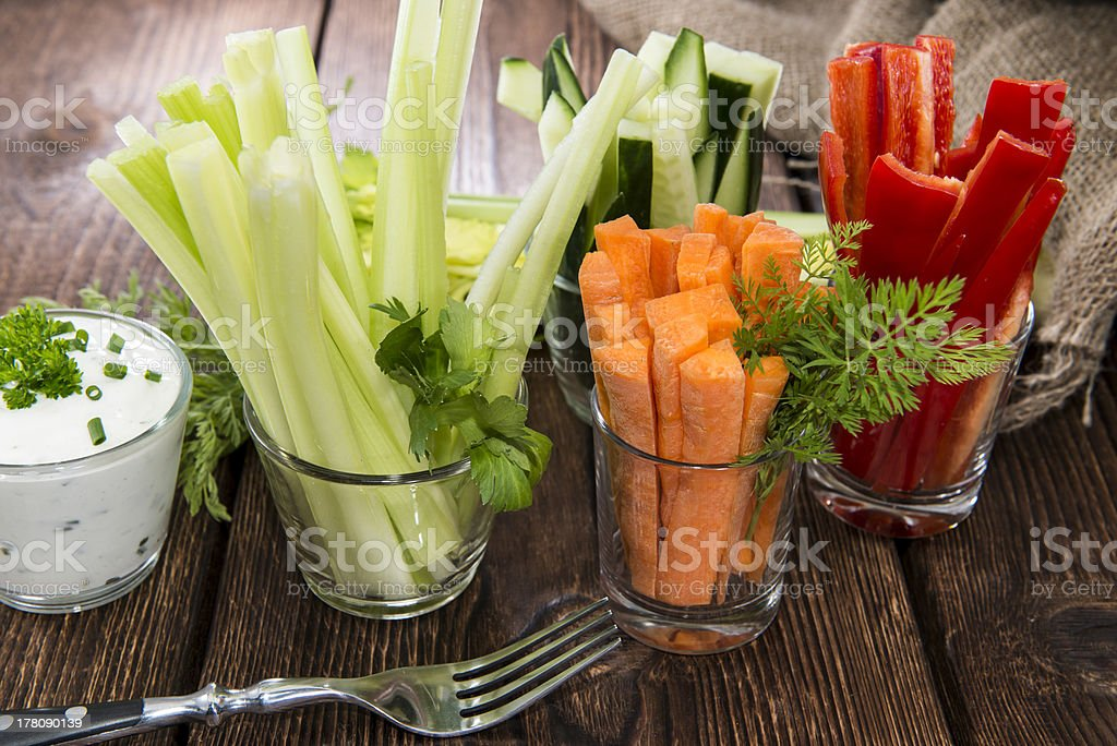 Fresh vegetables in clear glasses and white dip stock photo