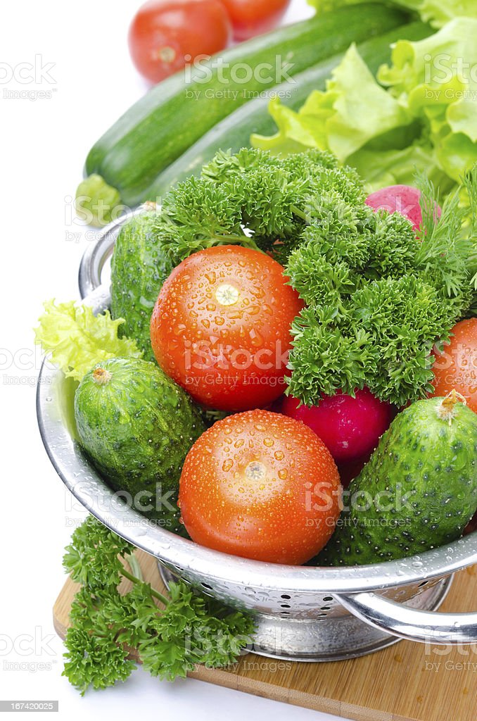 fresh vegetables in metal colander isolated on white royalty-free stock photo