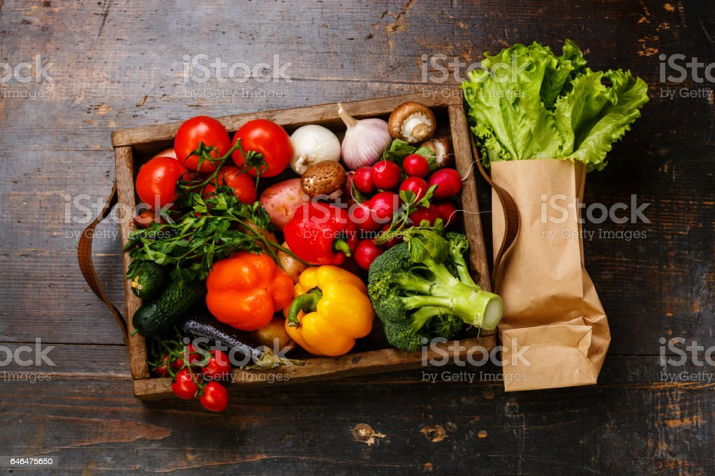 Fresh vegetables in wooden box and lettuce stock photo