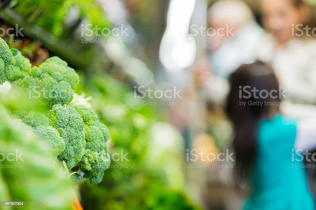 Fresh vegetables kept cold in produce section of grocery store stock photo