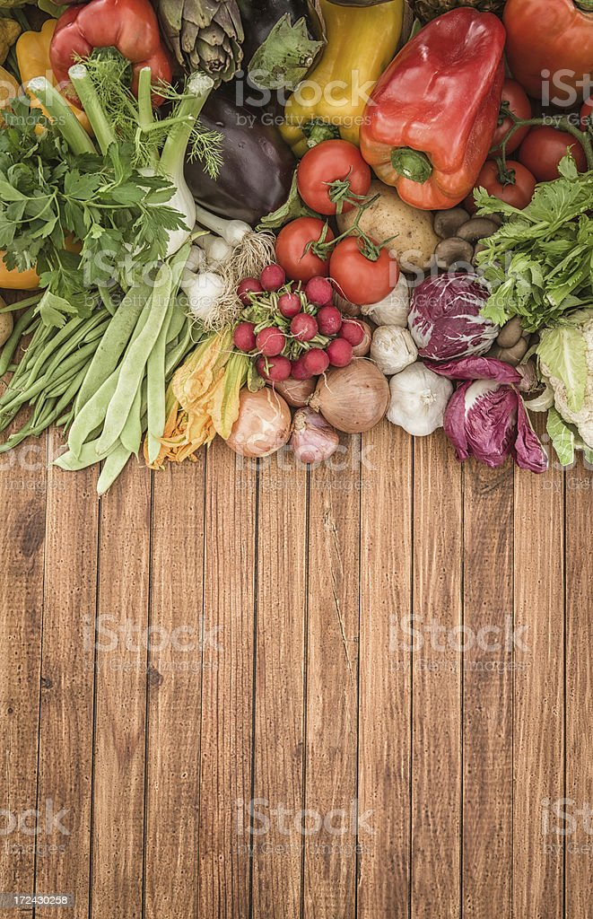 Fresh vegetables mix on wood plank stock photo