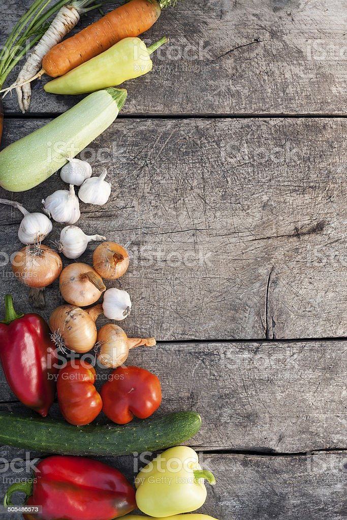 Fresh vegetables on rustic wooden background stock photo