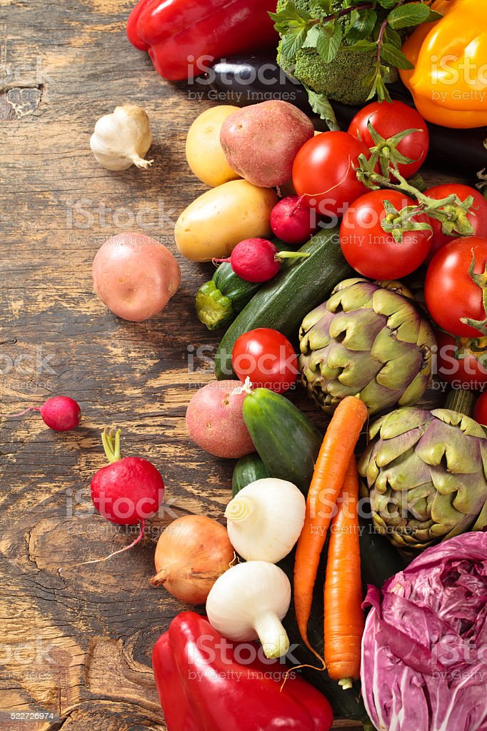 Fresh vegetables on wooden background. stock photo