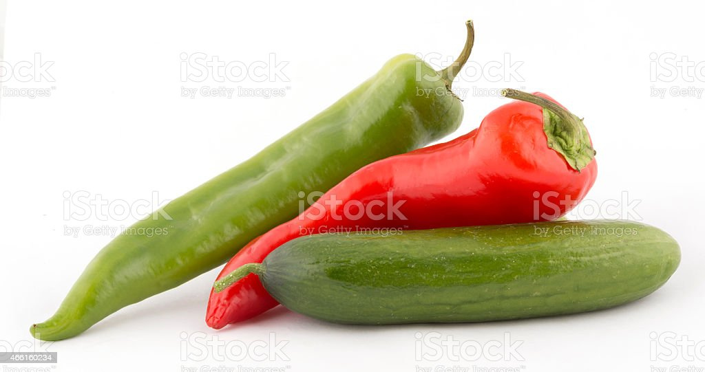 fresh vegetables. pepper and cucumber. isolated on white background. stock photo