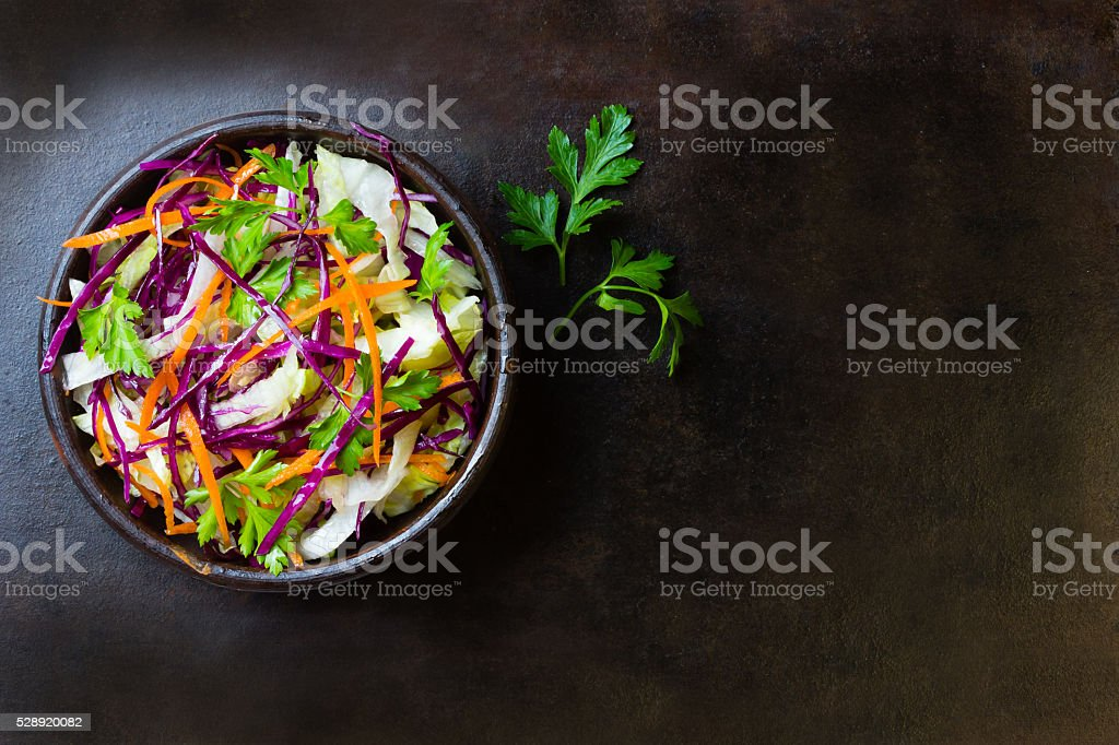Fresh vegetables salad purple cabbage, lettuce, carrot. Top view stock photo
