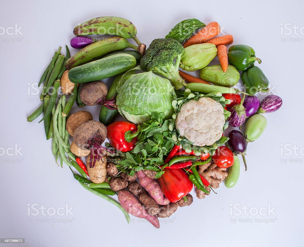 fresh vegetables with heart shape stock photo