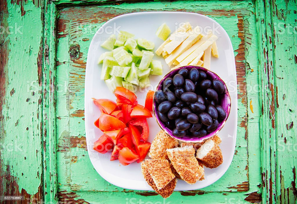 Fresh vegetarian cut snack on weathered board stock photo