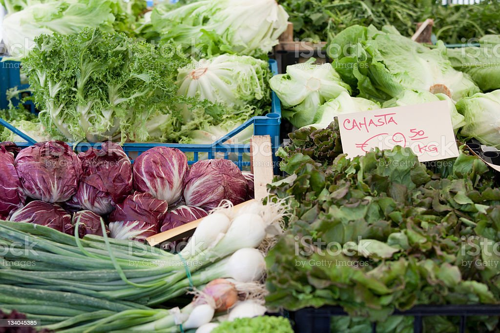 Fresh vegetarian greens at open street vegetable market royalty-free stock photo