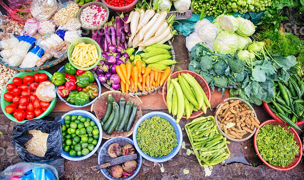 Fresh Vietnamese vegetables fruits spices displayed at Hanoi street market stock photo