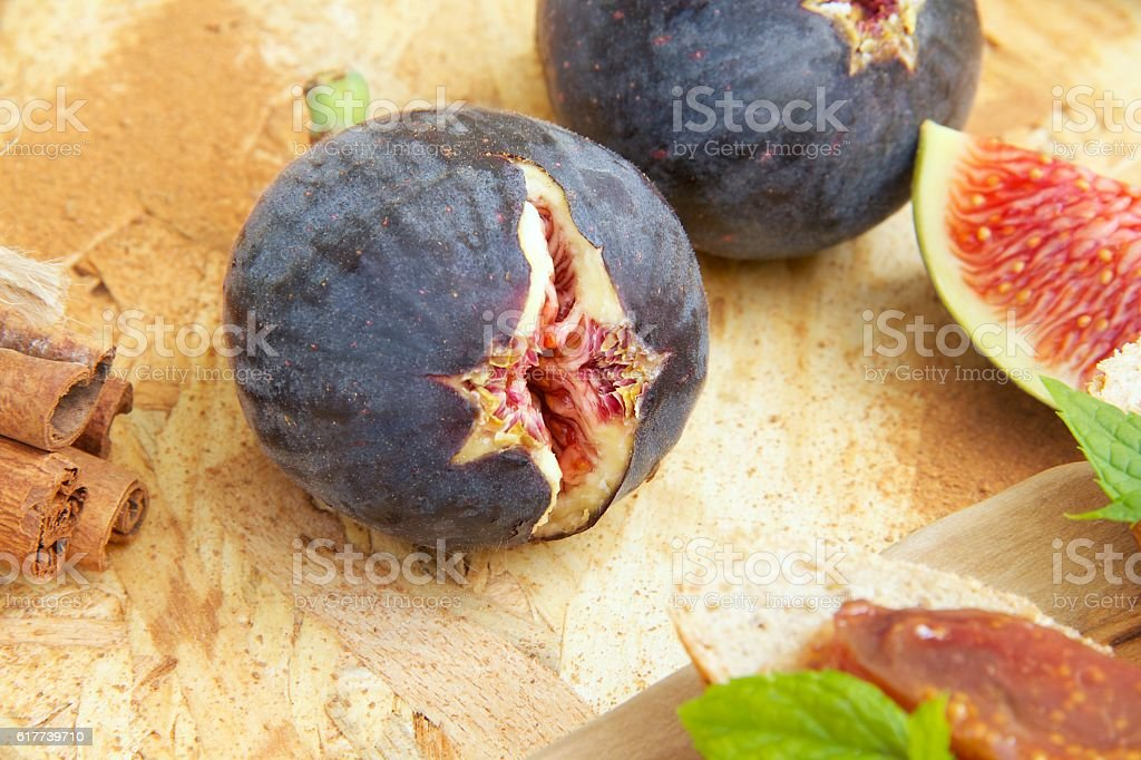 Fresh violet fig and cinnamon sticks stock photo