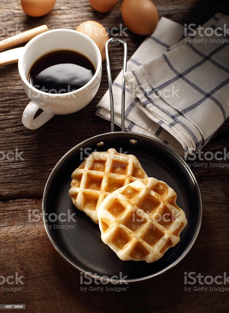 Fresh Waffles and hot coffee for breakfast set with eggs stock photo