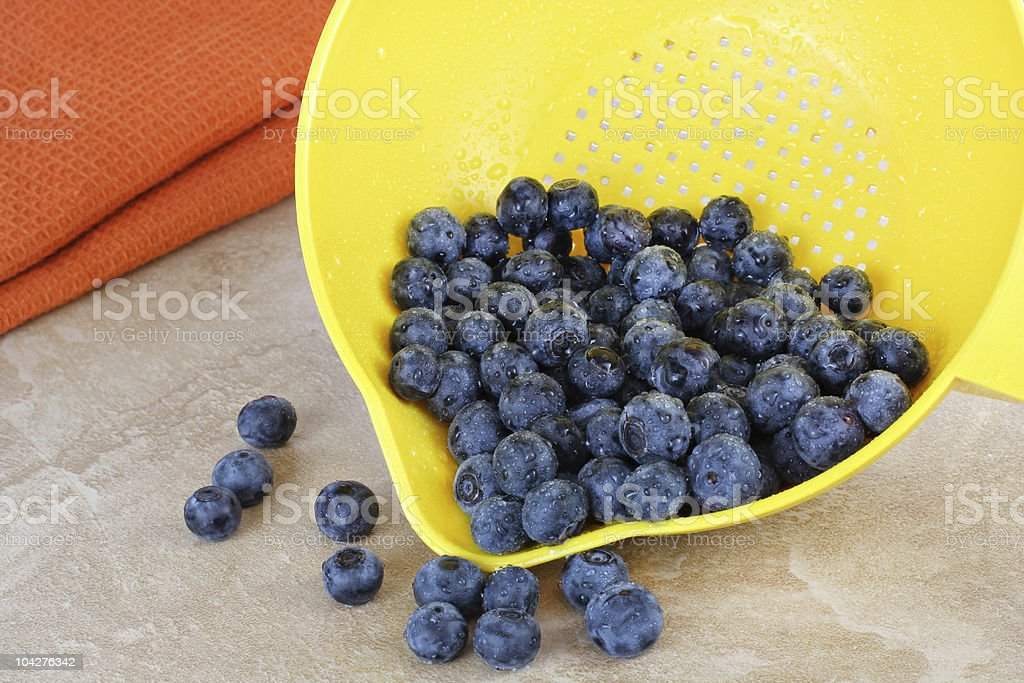 Fresh washed blueberries and strainer. royalty-free stock photo