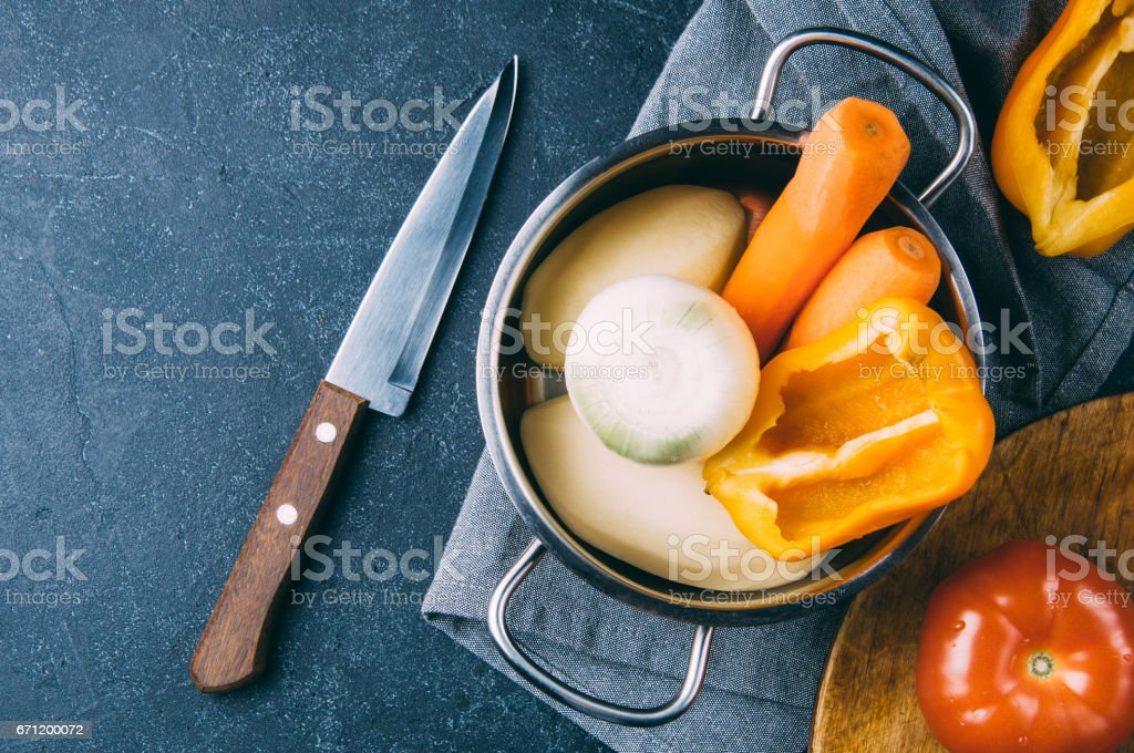 Fresh washed vegetables in the pan. Dark style shot stock photo