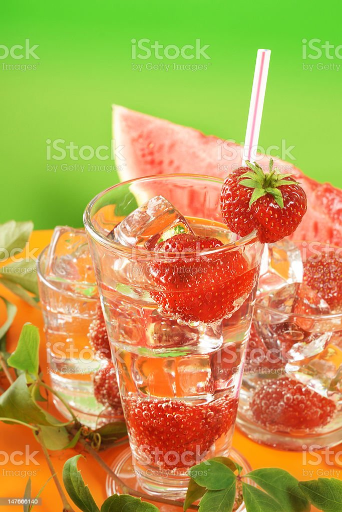 Fresh water and strawberries stock photo