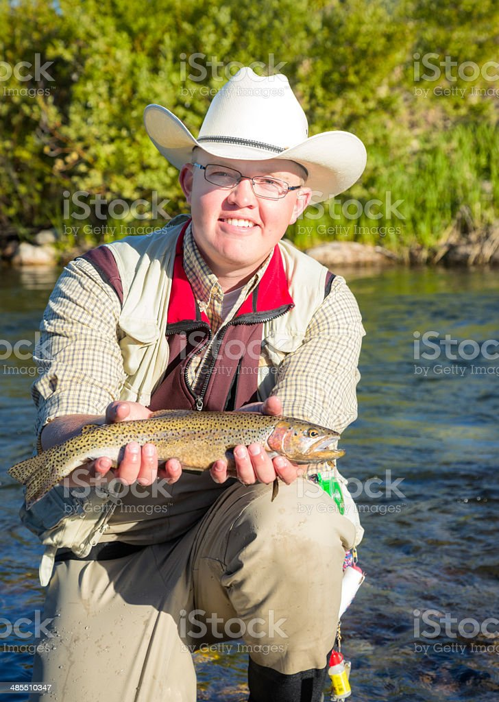 Fresh water fisherman proud of his catch royalty-free stock photo