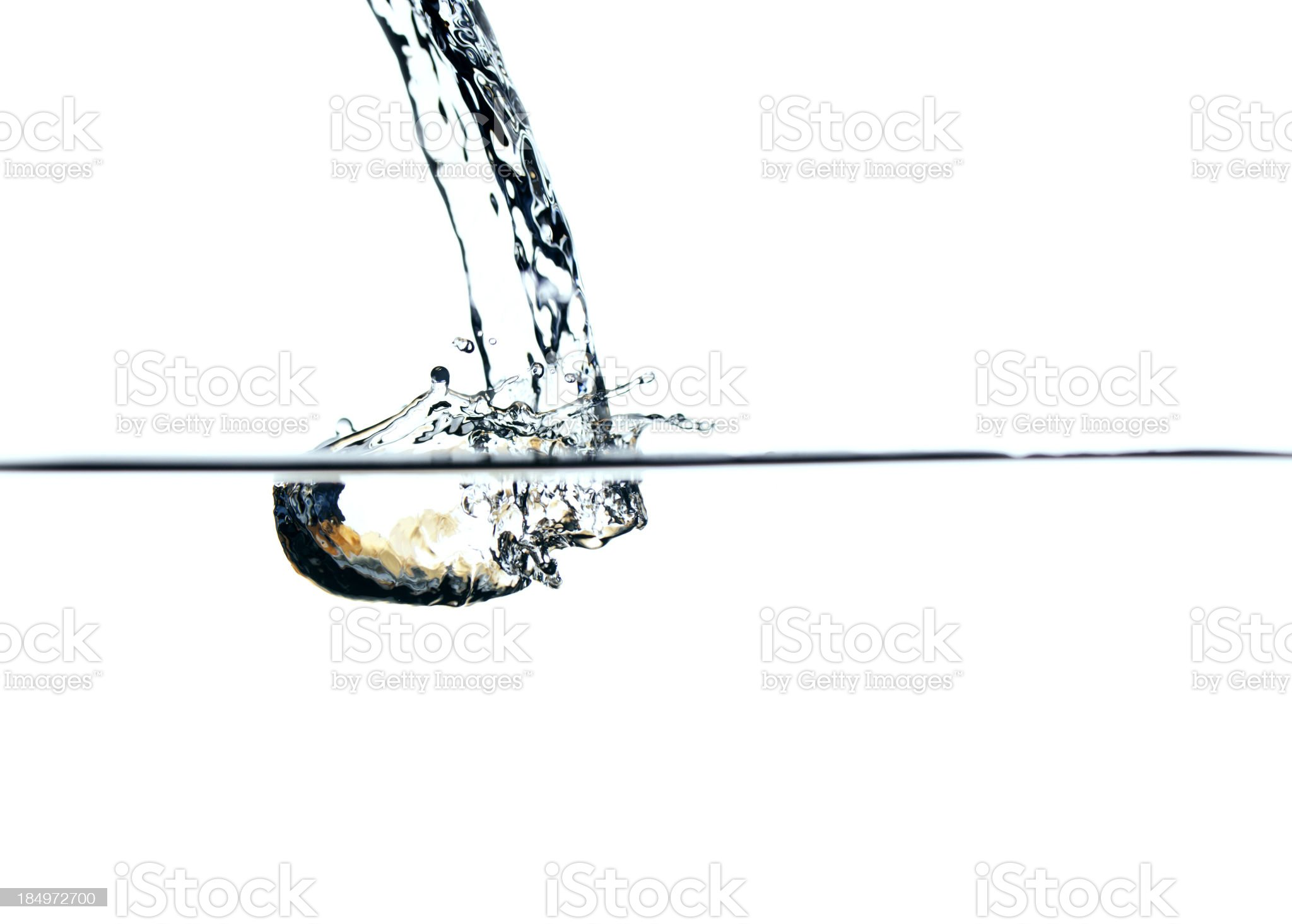 Fresh water poured into a container royalty-free stock photo