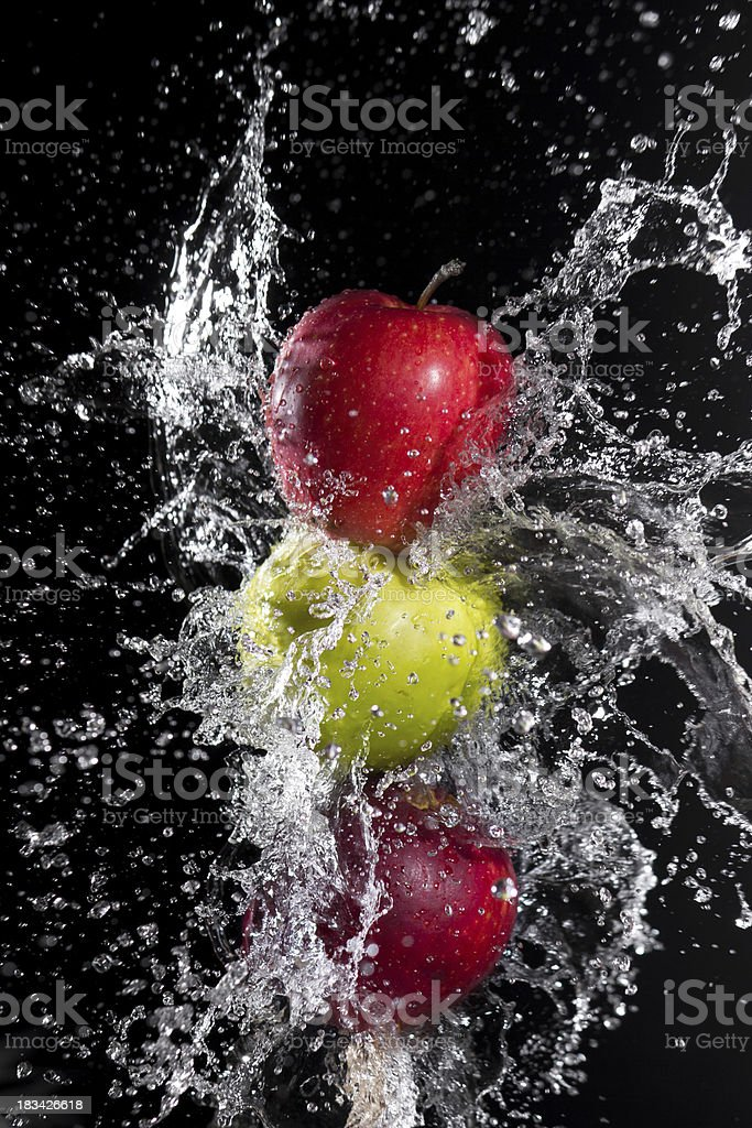 Fresh water splash and apples royalty-free stock photo