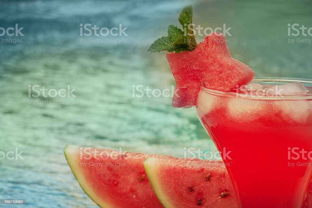 Fresh watermelon juice on a swimming pool stock photo