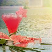 Fresh watermelon juice on a swimming pool