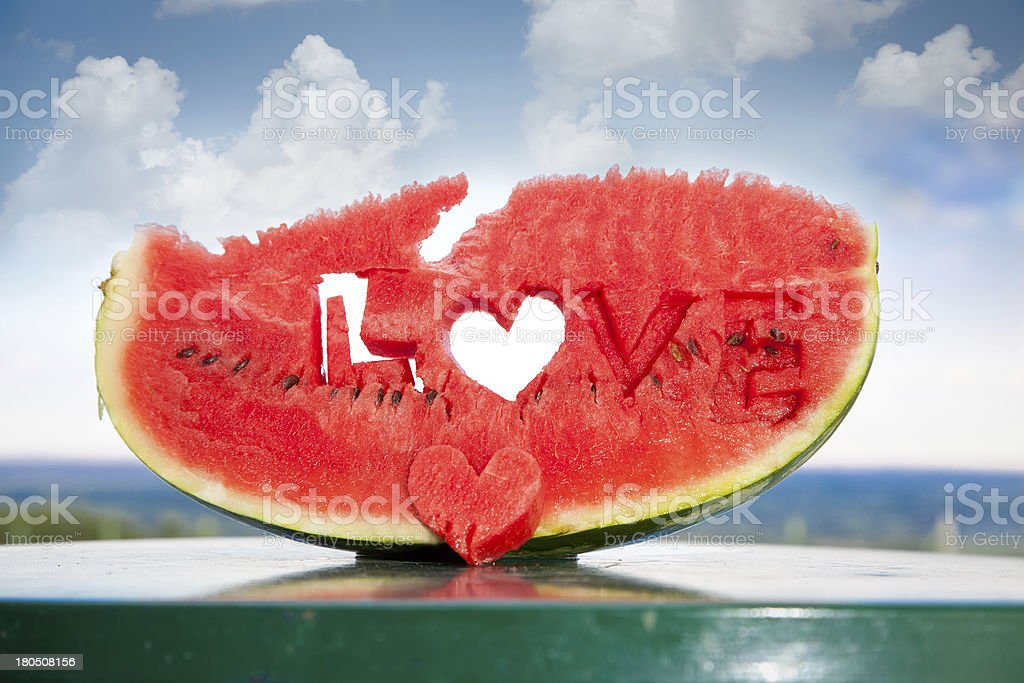 Fresh watermelon slice  with love letters word royalty-free stock photo