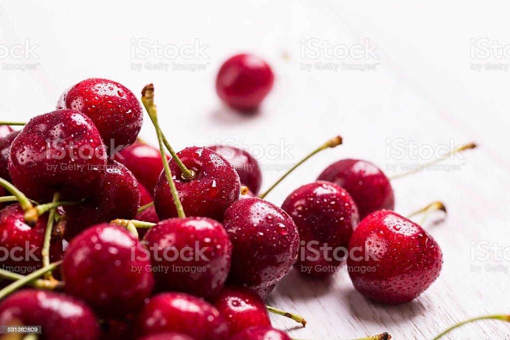 fresh wet cherry on wooden background stock photo