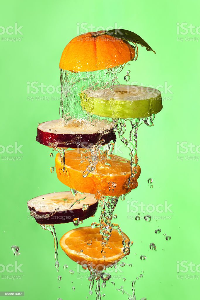 Fresh Wet Citrus Fruit Slices Tossed in Air royalty-free stock photo