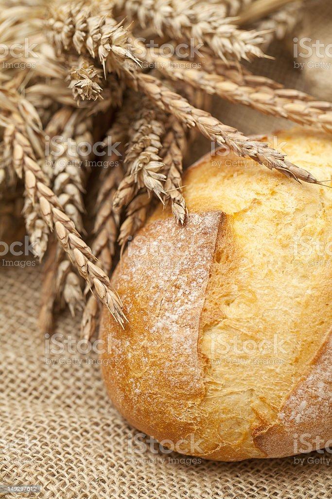 fresh wheat bread on burlap royalty-free stock photo