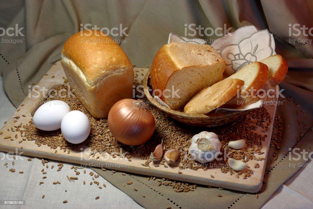 fresh wheat bread on wooden cutting Board stock photo