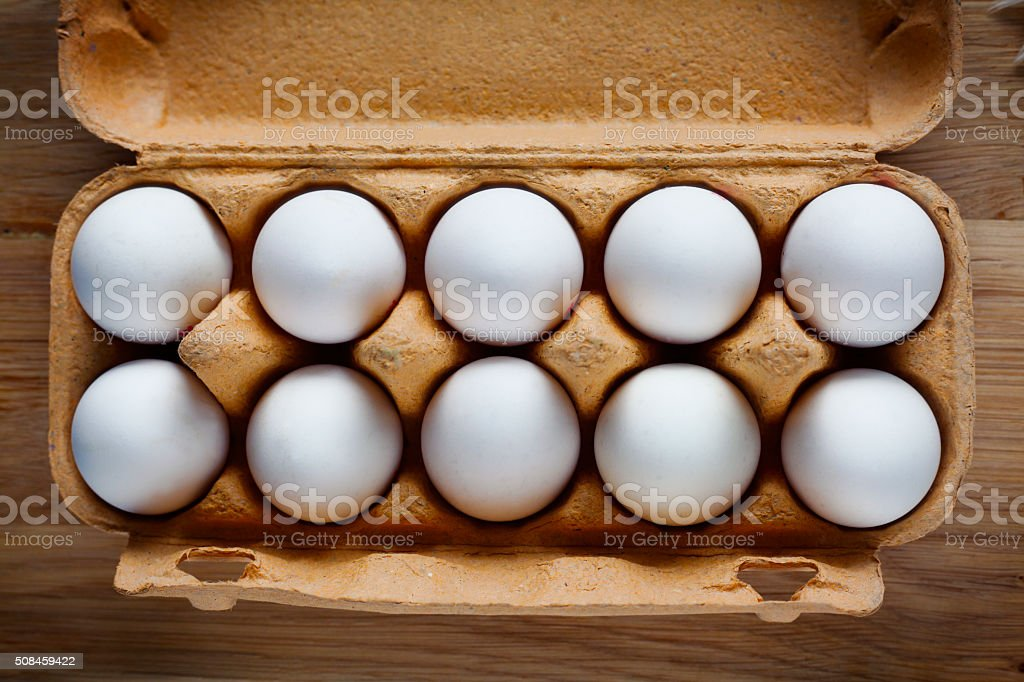 Fresh white eggs in the cardboard box stock photo