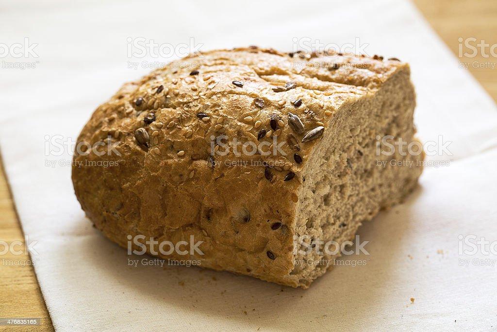 Fresh whole grain bread cut in half royalty-free stock photo