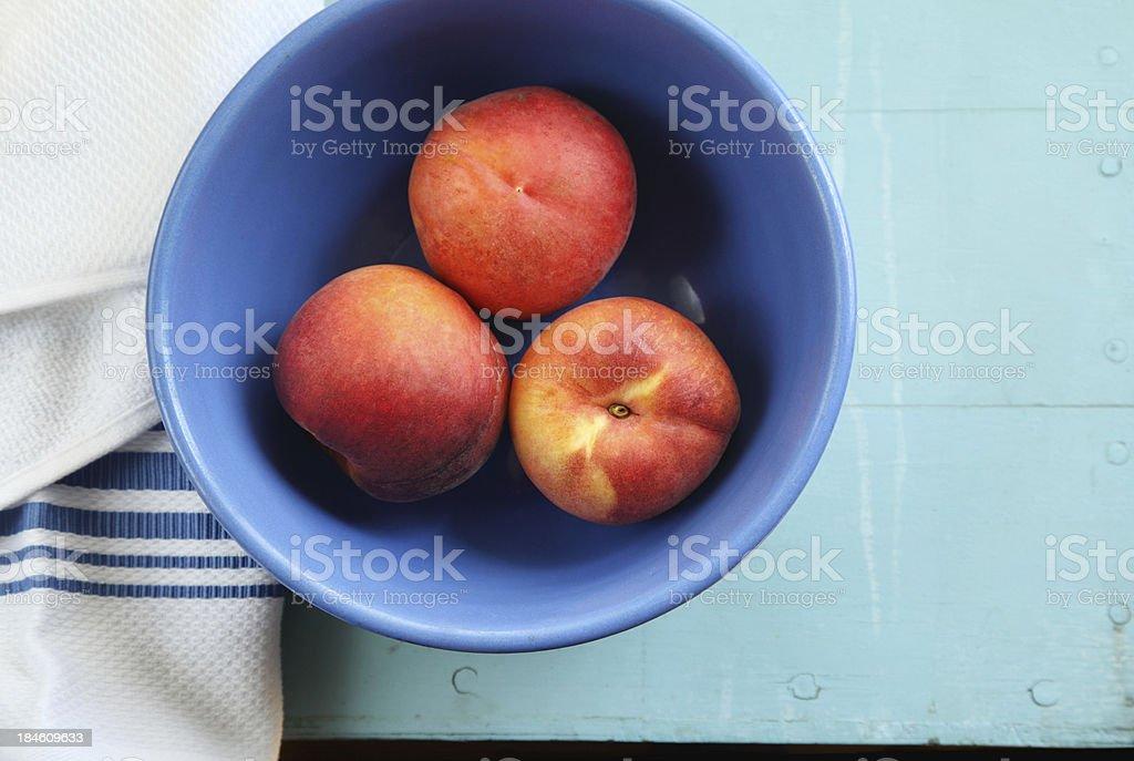 Fresh Whole Peaches in Bowl stock photo